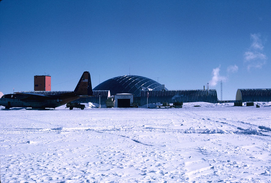 A US Navy LC-130 airplane in front of the geodesic Dome.