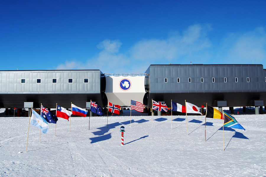 Flags fly at the ceremonial South Pole in honor of the 12 original signatory nations of the Antarctic Treaty.